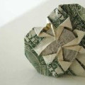 Money origami - Dollar bill folded into a heart around a coin