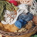 Multicolored wool in a basket