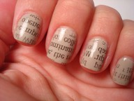 Woman's hand with newsprint art fingernails