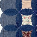 Recycled denim pieced together to make a circle pattern quilt from old jeans