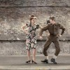 Man and woman dancing in clothing of the WWII era